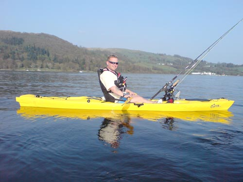 t-shirt and shorts on a kayak fishing in lake windermere